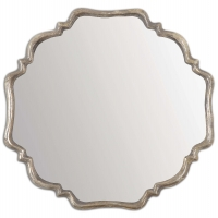 UZIMA is a shapely mirror with a plated, oxidized silver and greay wash frame.