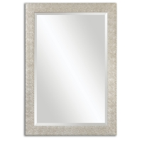 "Frame has a Textured Profile in a Lightly Antiqued Silver Finish.  The Mirror has a generous 1.25"" bevel."
