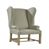 Faolan Accent Chair features and Solid Hardwood frame with Oak exposed legs.  The Upholstery in a Neutral Linen Blend accents with Upholsterers tacks.  This is a great modified wing chair.