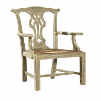 Faith Arm Dining Chair is Constructed of Hardwoods with a Bleached FInish and a Rattan Slip Seat.