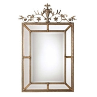 """Ulyana is an Ornate Mirror with classical french styling. The Frame is Ornately Gold Gildedwith agray wash. The Center mirror features a generous 1.25"""" bevel."""