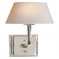 Modern Single Light Sconce with a Crystal accented Back Plate.  Shown in Polished Nickel. Holds 1 B Lamp- 40 Watt Max (Not Included). U.L. Listed