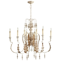 French Style Carved Wood Chandelier with Distressed Ivory FInish.  Eight arms are in Iron with Gold accents. Holds 8 B Lamps- 45 Watt Max Each (Not Included) U.L. Listed