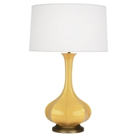 Raanan Ceramic Table Lamp Shown in Sunset Yellow with Soft Brass base.  The Lamp comes with a Barrel Hardbacked Linene Shade as Shown. Fixture Holds 1 A Lamp, 150w max (not included) U.L. Listed