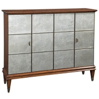 Eddy is a Simple Modern Accent cabinet Constructed of Hardwoods and Finished in Medium Walnut Stain. The Front 4 Bifolding Doors have Antique Silver Leaf Detailing. The Interior has a Shelf. This narrow cabinet is ideal for hallways or entryways.