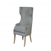 Uma Modified Wing Chair is Upholstered in Gray Linen Blend Fabric with Bleach Oak Legs and Nailhead trim.
